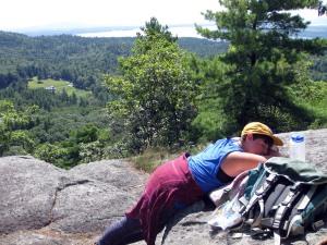 Brigid takes a nap on the Coon Mountain summit.