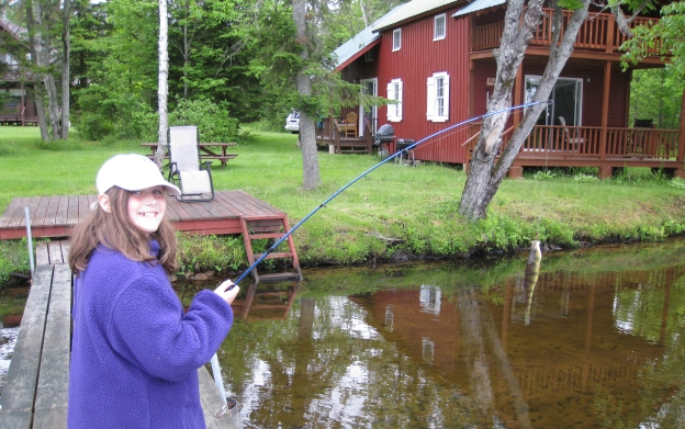 Brigid fishing at camp on Chateaugay Lake