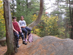 Friends Brigid and Eniola taking a break at a favorite photo-op spot on the Silver Lake Mountain trail.