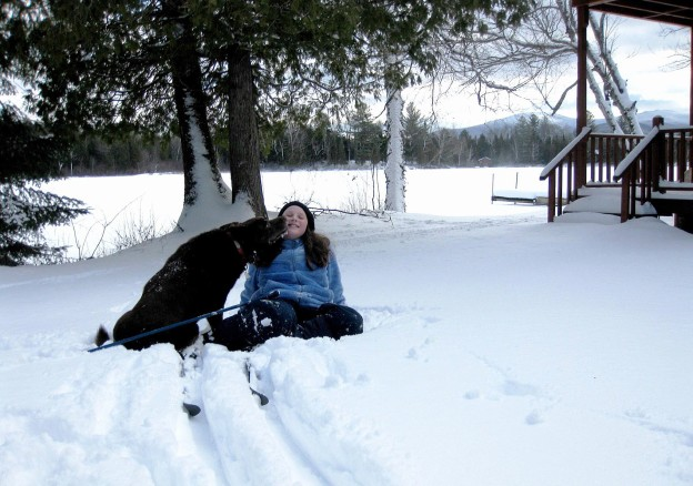 Brigid takes a ski break with a furry friend.